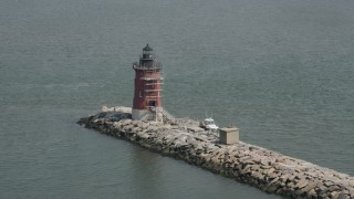 AX72_028 - 5K stock footage aerial video orbiting the Delaware Breakwater East End Light