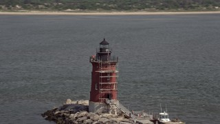 AX72_031 - 5K stock footage aerial video flying by the Delaware Breakwater East End Light