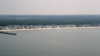 AX72_032 - 5K stock footage aerial video of beachfront homes in Lewes, Delaware, seen from Delaware Bay