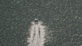 AX72_034 - 5K stock footage aerial video of a speedboat racing across Delaware Bay