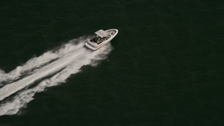 AX72_035 - 5K stock footage aerial video of a speedboat cruising across Delaware Bay