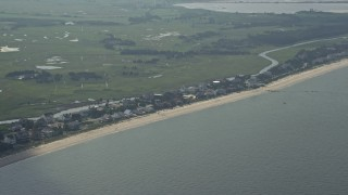 AX72_036 - 5K stock footage aerial video of beachfront houses in Broadkill Beach, Delaware