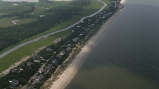 AX72_037 - 5K stock footage aerial video of beachfront homes and creek in Broadkill Beach, Delaware