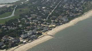 AX72_038 - 5K stock footage aerial video of beachfront neighborhoods in Broadkill Beach, Delaware