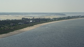 AX72_039 - 5K stock footage aerial video of a row of beachfront homes in Prime Hook Beach, Delaware