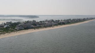 AX72_040 - 5K stock footage aerial video flying by beachfront houses in Prime Hook Beach, Delaware