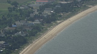 AX72_046 - 5K stock footage aerial video of beach goers at Slaughter Beach, Delaware