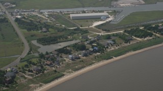 AX72_048 - 5K stock footage aerial video of beachfront homes by a large warehouse building in Milford, Delaware