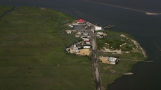 AX72_049 - 5K stock footage aerial video of Mispillion Light by Delaware Bay in Milford, Delaware
