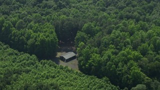 AX72_053 - 5K stock footage aerial video of an isolated cabin in the woods in Milford, Delaware