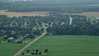 AX72_059 - 5K stock footage aerial video of rural homes and fields in Frederica, Delaware