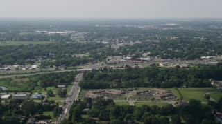 AX72_066 - 5K stock footage aerial video of office buildings, strip malls, and homes in Dover, Delaware