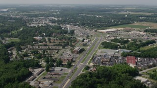 AX72_068 - 5K stock footage aerial video of shops and apartment buildings along Dupont Highway in Dover, Delaware