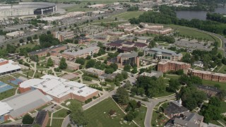 AX72_082 - 5K stock footage aerial video flying by the Delaware State University campus in Dover