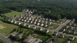 AX72_083 - 5K stock footage aerial video of rows of tract homes in Dover, Delaware