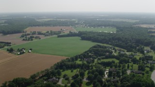 AX72_084 - 5K stock footage aerial video of farms and farm fields in Dover, Delaware