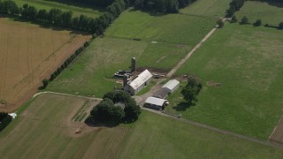 AX72_087 - 5K stock footage aerial video of a barn, silos, and farm fields in Dover, Delaware