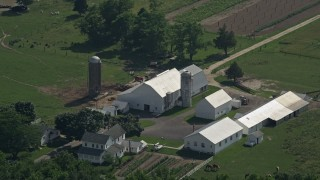 AX72_088 - 5K stock footage aerial video approaching a farmhouse, barn, and silos in Dover, Delaware