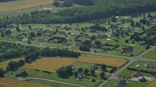 AX72_091 - 5K stock footage aerial video of rural neighborhood in Hartly, Delaware