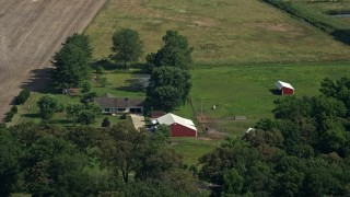 AX72_098 - 5K stock footage aerial video of a ranch house and barns with horses in Henderson, Maryland