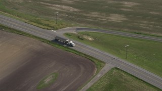AX72_101 - 5K stock footage aerial video of a truck traveling on Goldsboro Road in Ingleside, Maryland