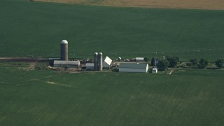AX72_103 - 5K stock footage aerial video of barns and silos by crop fields in Ingleside, Maryland
