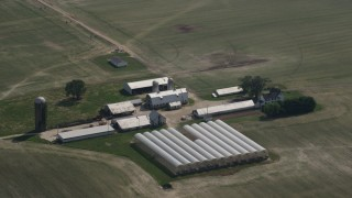 AX72_104 - 5K stock footage aerial video of barns, greenhouses, silos, and a farm house in Ingleside, Maryland