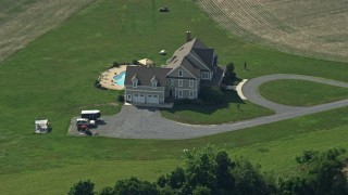 AX72_107 - 5K stock footage aerial video of an isolated rural home with a pool in Centreville, Maryland