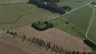 AX72_109 - 5K stock footage aerial video of a small farm house and crop fields beside a country road in Centreville, Maryland