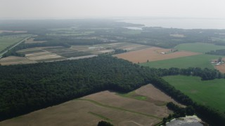 AX72_116 - 5K stock footage aerial video flying over fields and farms in Queenstown, Maryland