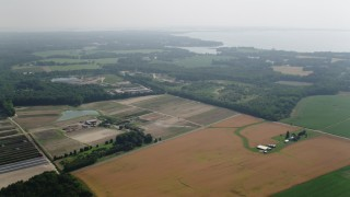 AX72_117 - 5K stock footage aerial video of farmland by Main Street in Queenstown, Maryland