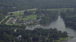 AX72_118 - 5K stock footage aerial video of riverfront homes by Little Queenstown Creek in Queenstown, Maryland