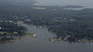 AX72_121 - 5K stock footage aerial video of riverfront homes by Winchester Creek in Grasonville, Maryland