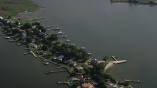 AX72_122 - 5K stock footage aerial video of riverfront homes with docks on a peninsula by Chester River in Grasonville, Maryland