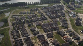 AX72_123 - 5K stock footage aerial video approaching a suburban neighborhood in Chester, Maryland