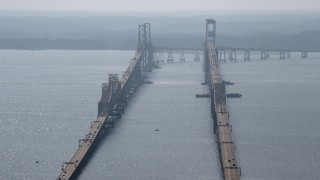 AX72_129 - 5K stock footage aerial video flying by the Chesapeake Bay Bridge, Maryland