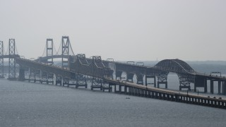 AX72_130 - 5K stock footage aerial video of Chesapeake Bay Bridge spanning the bay in Maryland