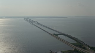 AX73_001 - 5K stock footage aerial video flying by Chesapeake Bay Bridge spanning the bay in Maryland