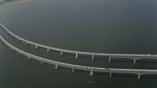 AX73_006 - 5K stock footage aerial video of light traffic crossing the Chesapeake Bay Bridge, Maryland