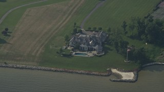 AX73_007 - 5K stock footage aerial video of a mansion on shore of Chesapeake Bay in Annapolis, Maryland