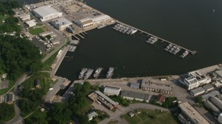 AX73_027 - 5K stock footage aerial video of Navy ships docked in a harbor in Annapolis, Maryland