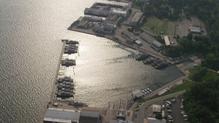 AX73_029 - 5K stock footage aerial video of a small harbor with docked Navy ships in Annapolis, Maryland