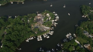 AX73_032 - 5K stock footage aerial video of riverfront homes with docks by Mill Creek in Annapolis, Maryland