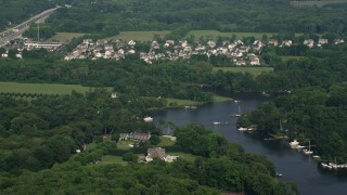 AX73_034 - 5K stock footage aerial video of a suburban neighborhood near Whitehall Creek in Annapolis, Maryland