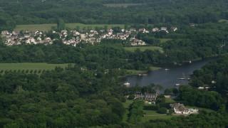 AX73_034 - 5K stock footage aerial video of a suburban neighborhood near Whitehall Creek in Annapolis, Maryland