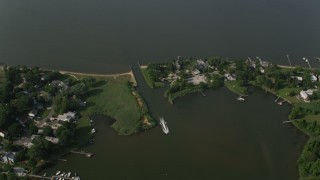 AX73_036 - 5K stock footage aerial video of waterfront homes and small inlet to Chesapeake Bay in Annapolis, Maryland