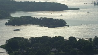AX73_040 - 5K stock footage aerial video of ferry on Redhouse Cove on Gibson Island, Maryland