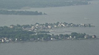 AX73_041 - 5K stock footage aerial video of waterfront homes and a marina in Hawk Cove on Sparrows Point, Maryland