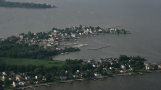 AX73_042 - 5K stock footage aerial video of waterfront homes and boats at a small marina in Hawk Cove at Sparrows Point, Maryland