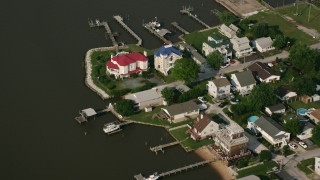 AX73_044 - 5K stock footage aerial video of waterfront homes with docks at Sparrows Point, Maryland